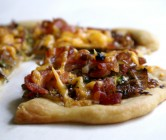 individual balsamic-glazed Brussels sprout, cheddar + bacon pizzas.