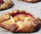 individual peach + strawberry galettes.