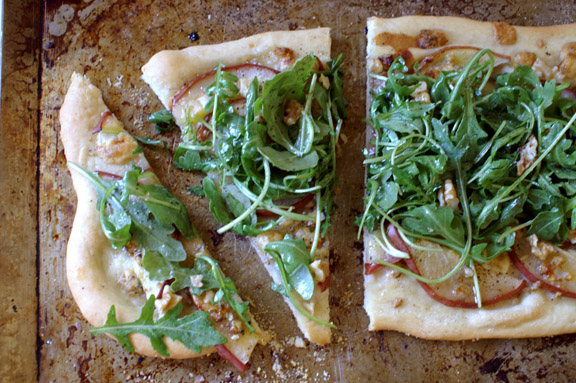red pear, arugula, and gorgonzola pizza with pomegranate vinaigrette.