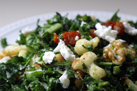 wintery kale salad with roast cauliflower, tomatoes, walnuts, and goat cheese.