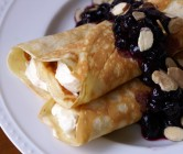 cheese-filled pannenkoeken with blueberry lemon sauce.