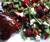 pomegranate molasses-glazed chicken thighs + tangled arugula and summer berry salad.
