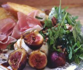 things on a plate: arugula, prosciutto, ricotta, fig, pecan, molasses
