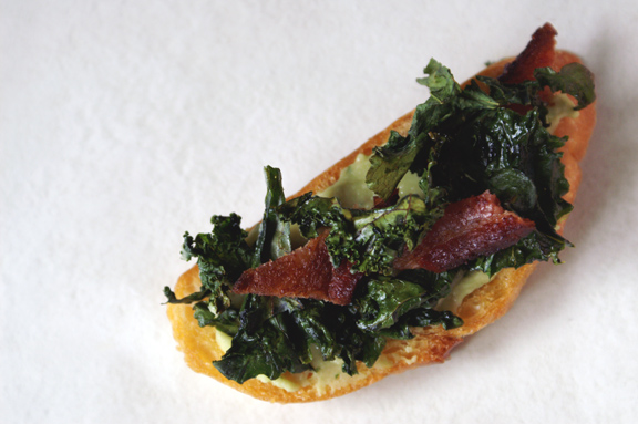 crispy kale + bacon toasts with lemony white bean puree.