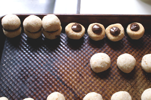 fig. 4: lining up cookies for chocolate piping.